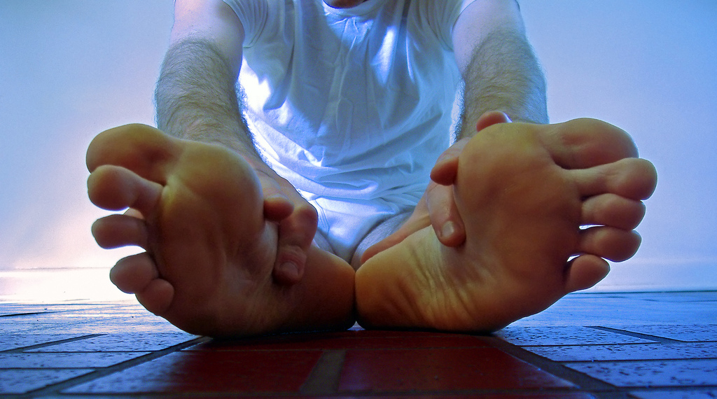 Plantar fasciitis typically causes a stabbing pain in the bottom of your foot near the heel.