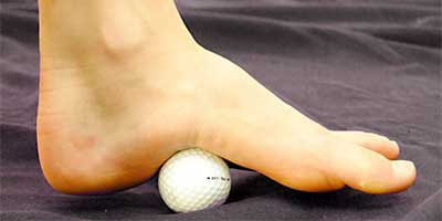 Rolling the foot on a golf ball helps relieve plantar fasciitis